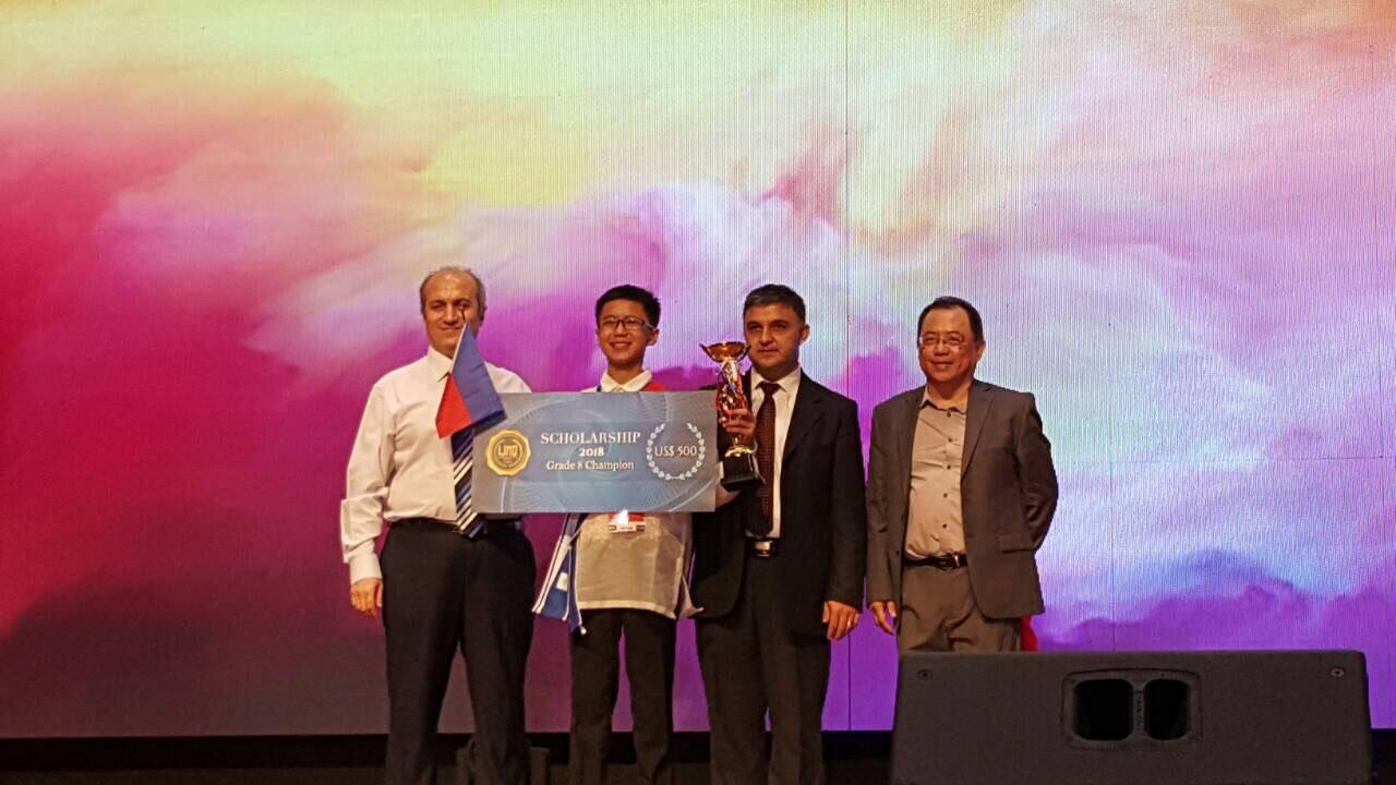 WINNING SMILE. Shawn Chua receives his award on stage. Photo courtesy of Eunice Chua