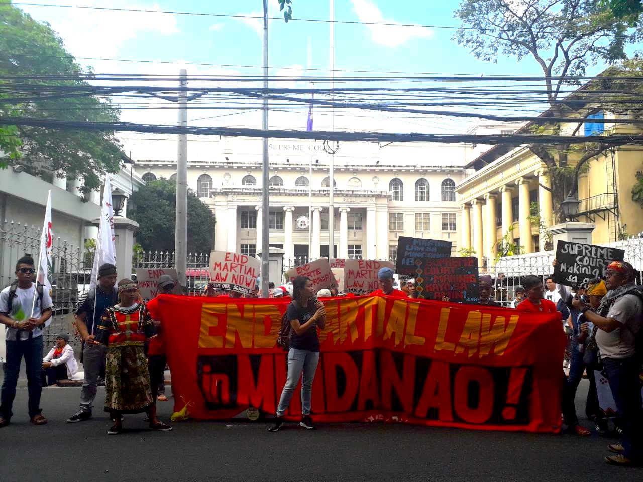 END MARTIAL LAW. A Lumad group holds banners calling for the end of martial law in Mindanao in front of the Supreme Court on January 22, 2019. Photo by Lian Buan/Rappler
