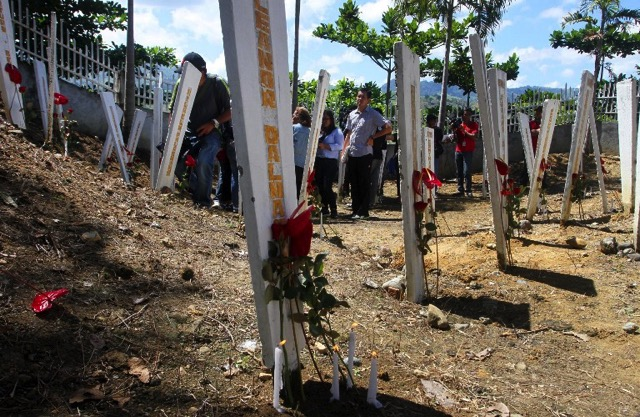 FIVE YEARS. Relatives and supporters of victims of the infamous massacre visit the site where 58 people were killed in Ampatuan town, Maguindanao province, in Mindanao on November 21, 2014, ahead of the 5th anniversary of the worst political massacre of the country. File photo by Mark Navales/AFP