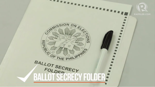 BALLOT. Give the voter a ballot secrecy folder and marking pen. Remind the voter how to properly shade the circles. Rappler photo