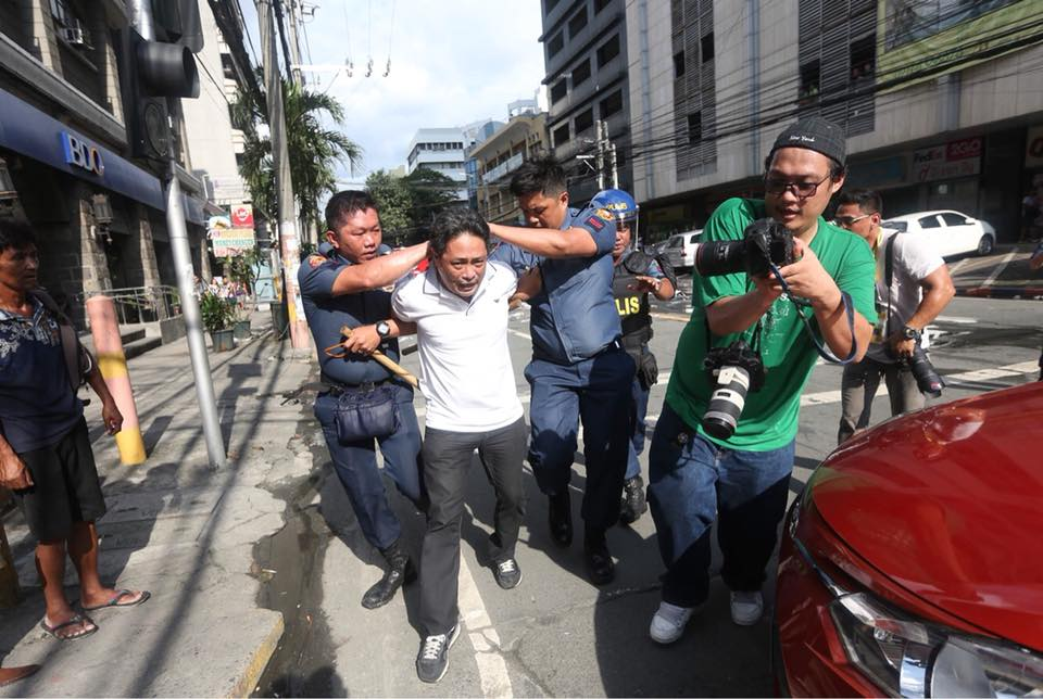 ARREST. Police and human rights group Karapatan tell different stories surrounding the arrest of Karapatan member Neil Legaspi on Sunday, November 12. Photo by Karapatan