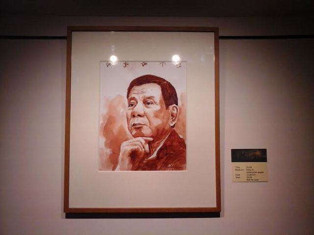TRIBUTE. The medium used in the painting was tuba, or coconut wine, on watercolor paper. Photo by Chris Billes/ Rappler