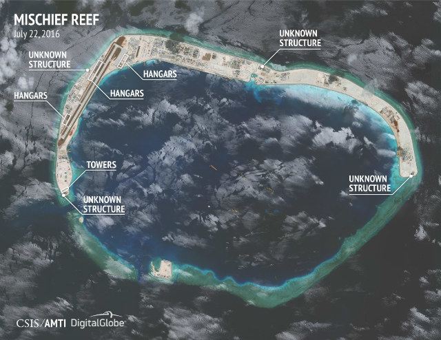 CHINA 'ISLAND.' Mischief Reef is the site of one of China's artificial islands in the West Philippine Sea (South China Sea). €˜Construction of hangars at Mischief Reef is at an earlier stage,€™ the Asia Maritime Transparency Initiative says of this satellite image dated July 22, 2016. Photo courtesy of CSIS/AMTI and DigitalGlobe
