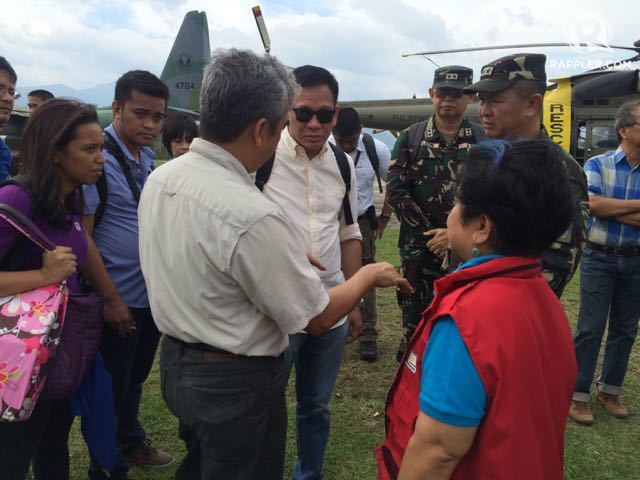 LET'S GO TO GROUND ZERO. DILG Sec Mel Sarmiento, DSWD Sec Dinky Soliman, and NDRRMC executive director Alexander Pama decide to fly to Casiguran, Aurora to hand over relief goods despite bad weather on October 21. Photo by Voltaire Tupaz