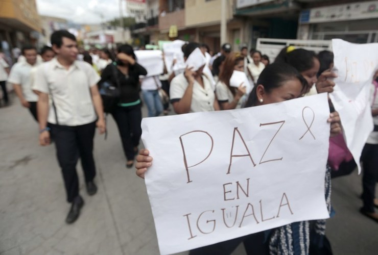 Students protest in demand of justice for the deaths of six people including students of Ayotzinapa and football players of the team
