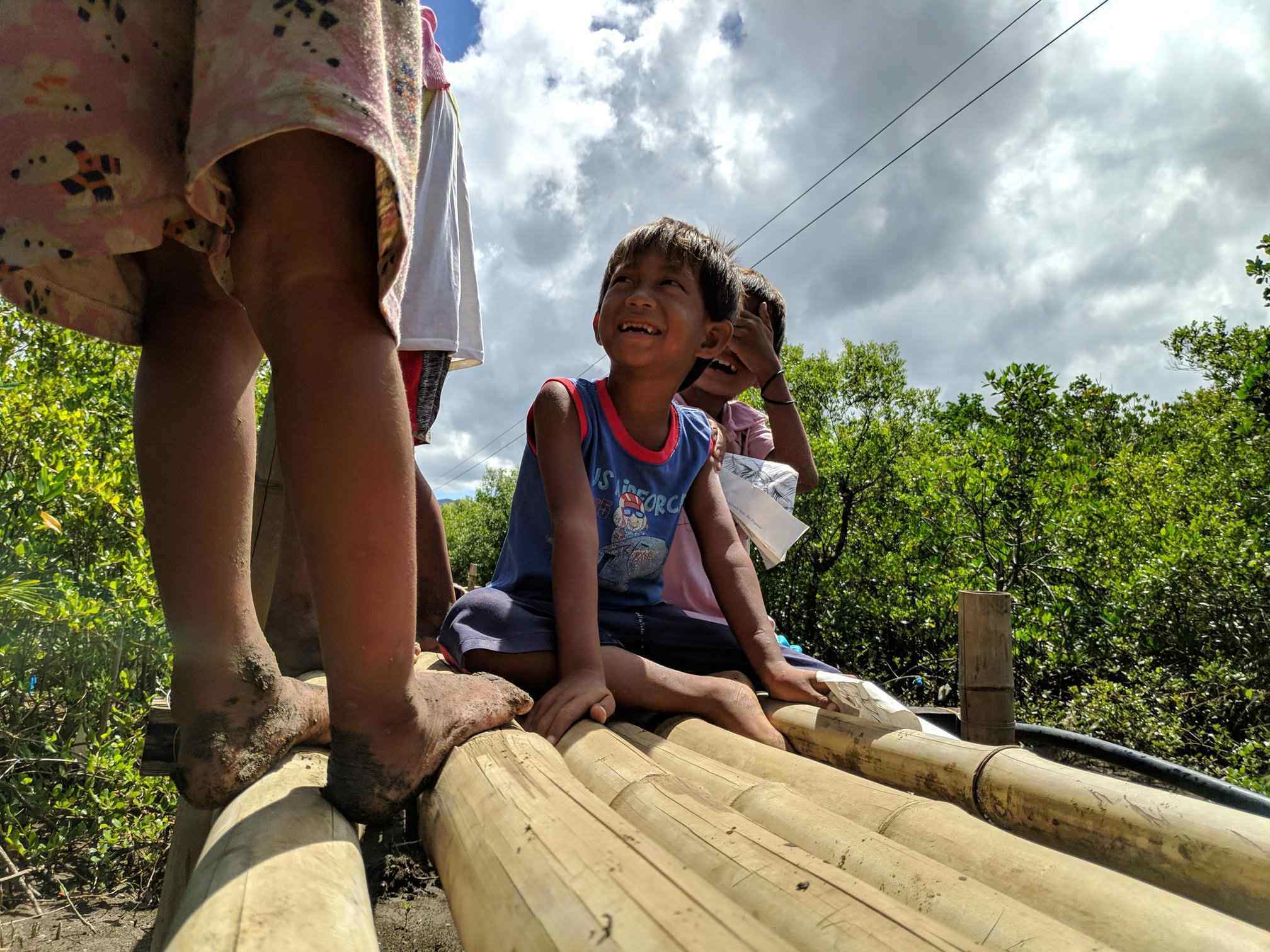 PLAYFUL. Under the scorching sun, Bajau kids play along the long and winding bamboo bridge leading to their community at Sitio Bawod, Isabel, Leyte on March 26, 2019. Photo by Kristian James Valenzona
