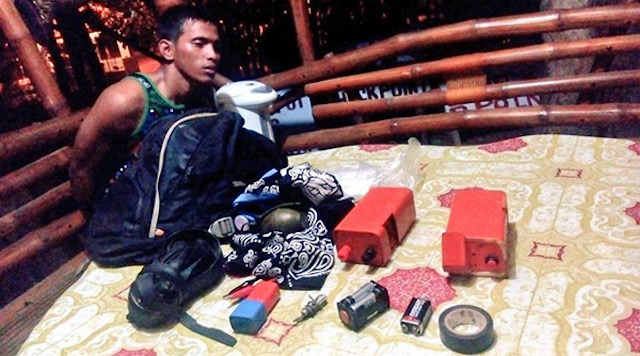 "APPREHENDED. Roy ""Steve"" Bulat-Ag Moreno is arrested for illegal possession of explosives. Photo from Task Force Davao"