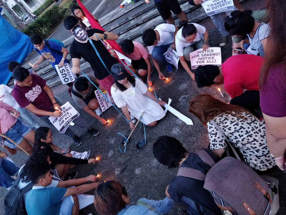 AGAINST SERENO OUSTER. The UPLB students light candles in protest of the Supreme Court decision to oust Chief Justice Sereno. Photo by Dyl Dalas