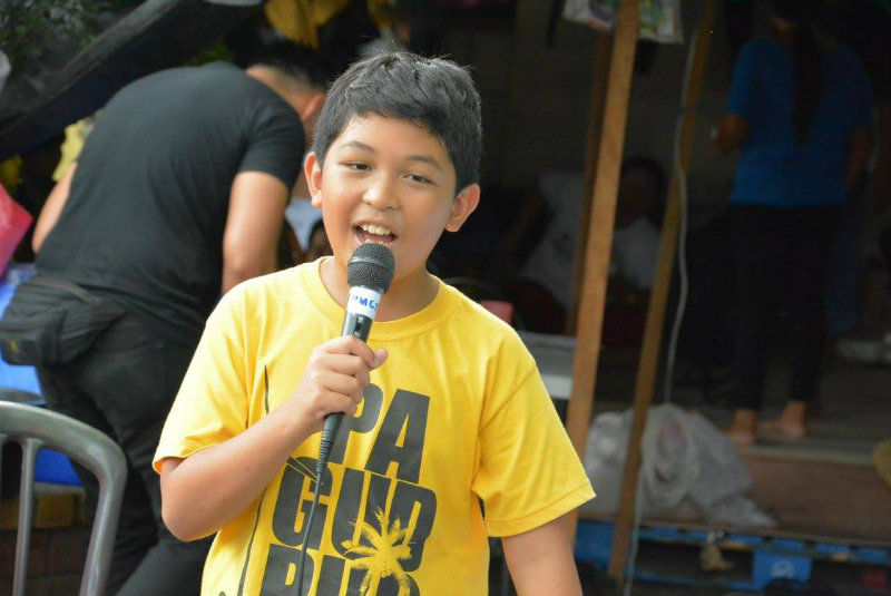 YOUNG ADVOCATE. At his young age, Fidelina Atregenio Jr. is witness to the bad effects of mining to Manicani and its residents. Photo courtesy of Roy Roberto