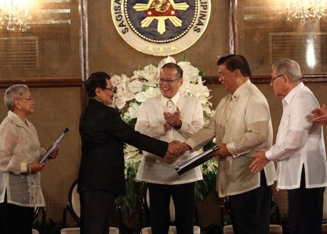 In this file photo, President Benigno S. Aquino lll witnesses the hand over of the draft Bangsamoro Basic Law by Bangsamoro Transition Commission Chairman Mohagher Iqbal and Secretary Teresita Quintos-Deles to Speaker of the House Feliciano Belmonte and Senate President Franklin Drilon during the turnover ceremony at Rizal Hall in Malacañan Palace, September 10, 2014. Photo by Rey Baniquet/NIB/Malacañang Photo Bureau