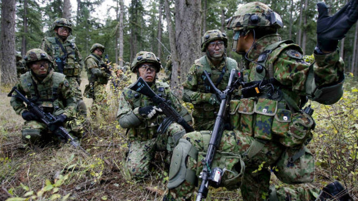 MILITARY POWER. Japanese soldiers from the 22nd Infantry Regiment of the Japan Ground Self-Defense Force train in urban assault with American soldiers from the 1st Battalion, 17th Infantry Regiment, 5th Brigade during an exercise at Fort Lewis' Leschi Town. Photo courtesy of US Army