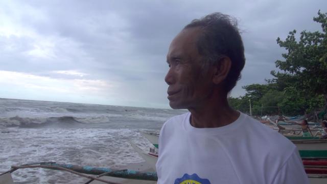 MEMORIES OF YOLANDA. Martin Zambales of Barangay Poblacion still remembers how the super typhoon battered their village in November 2013. Photo by David Lozada/ Rappler
