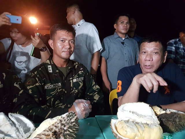 HAVING DURIAN. President Rodrigo Duterte has durian with the troops. Photo from the 10th Agila Division