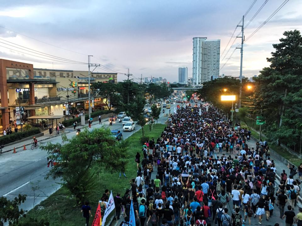 NOT A HERO. Students from the University of the Philippines Diliman march in Katipunan Avenue to converge with protesters from the 2 other schools. Photo by Katrina Artiaga/ Rappler