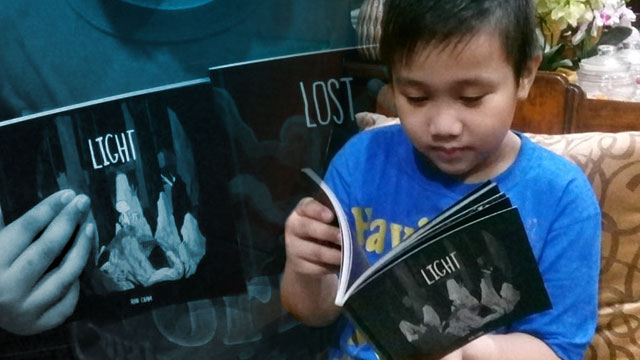 'LIGHT.' Benedique Vidad, cousin of Avie Uy, enjoys reading the 'Light' series. Photo courtesy of Avie Uy