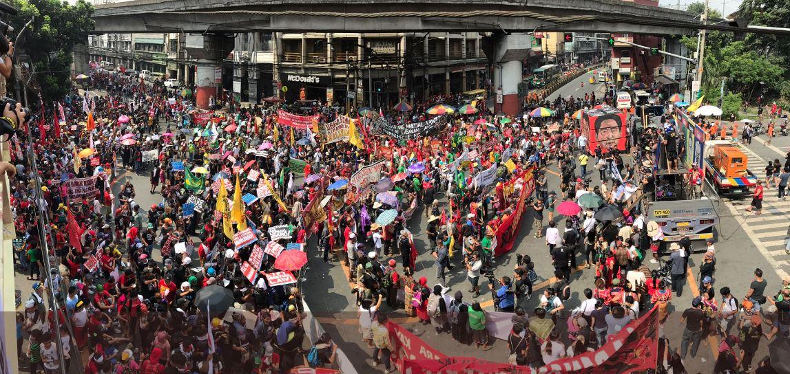 "SHOUT Protesters converge at Mendiola for the anti-Duterte rally. They shout: ""Duterte! Hitler! Diktador! Tuta!"