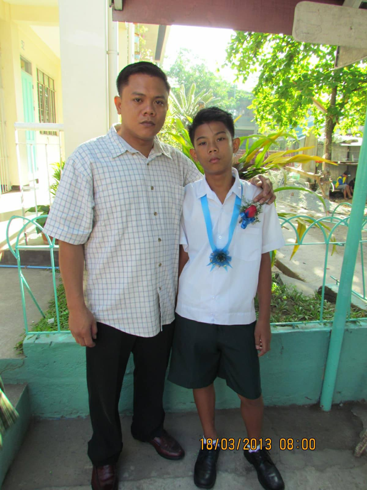 PROUD. Joaquin poses with his son Kiesten during his elementary graduation. Photo from Joaquin Nonan