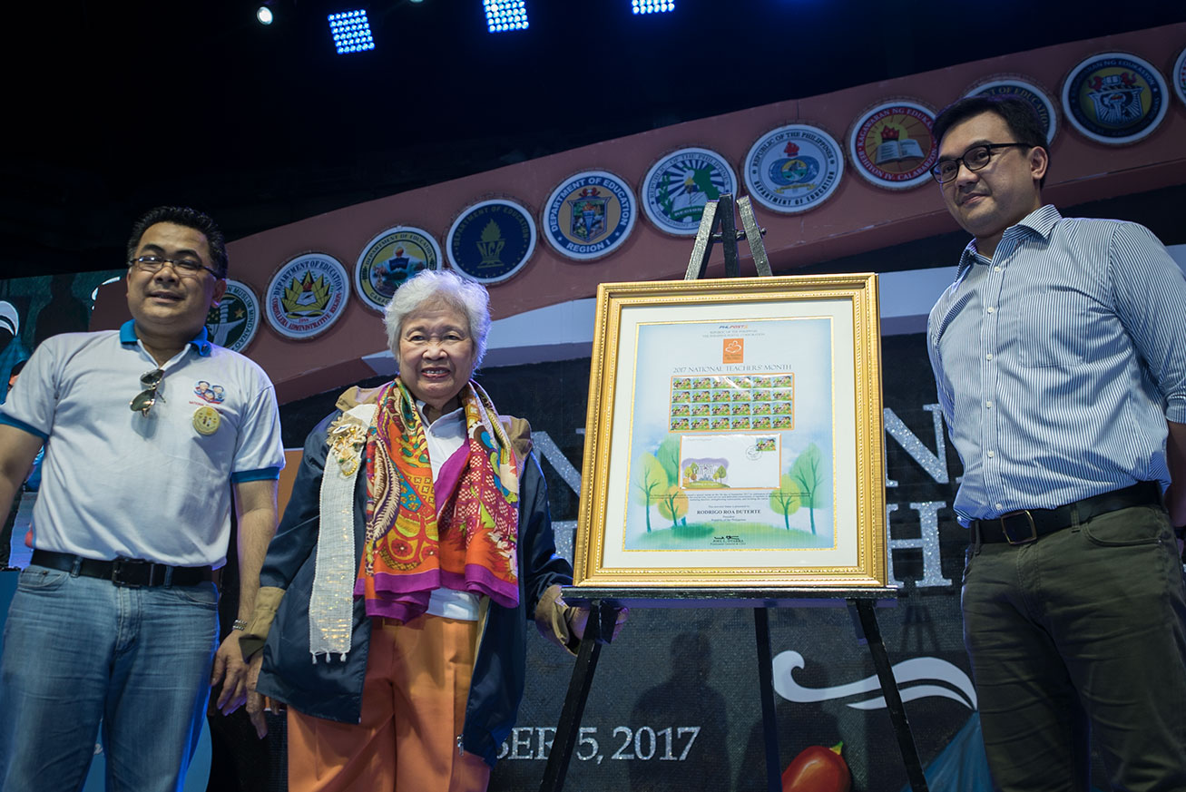 STAMPS. PhilPost turns over special commemorative stamps to the Department of Education, through Assistant Secretary Tonisito Umali (L) and Secretary Leonor Briones (center) during the National Teachers' Day celebration