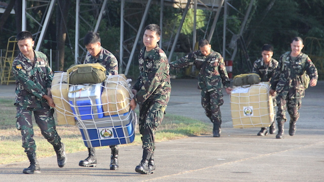 AIRDROP: The Philippine Navy airdrops supplies for the troops in Ayungin Shoal a month since the tense rotation mission. Photo from Western Command