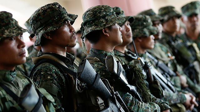 STANDING GUARD. Filipino soldiers man a provincial capital building turned into a military camp in Shariff Aguak, Maguindanao, March 31, 2015. File photo by Ritchie B. Tongo/EPA