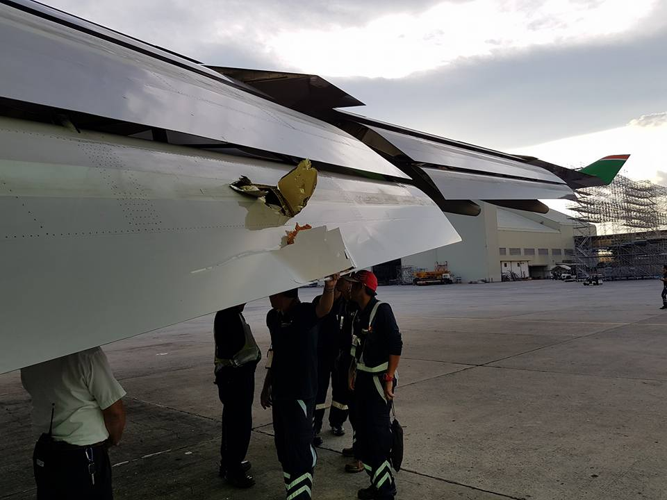 DAMAGE. The flaps of the EVA Air 272 were severely damaged by foreign object debris at the end of runway 24. Photo courtesy of Kurt Cabillon