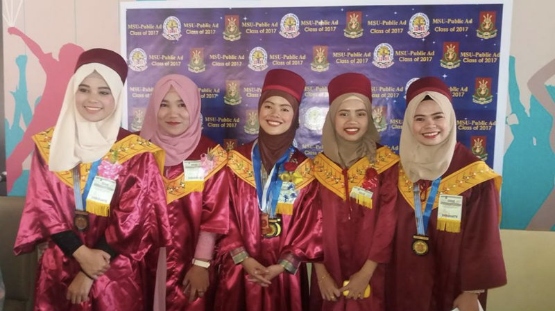 GRADUATE. Junaina Sharief (middle) is one of the 2,000 graduates of MSU Marawi City who marched to get their diplomas at MSU-IIT on Thursday, July 13, 2017. Photo courtesy of Junaina Sharief