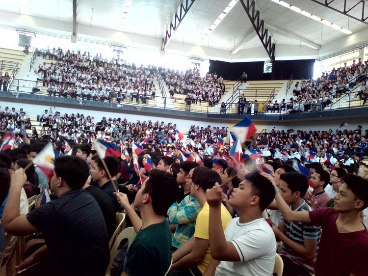 WAVING FLAGS. Xavier Ateneo Junior and Senior High School students wave their flags during the university's Philippine Independence Day celebration. Photo by Angelo Lorenzo