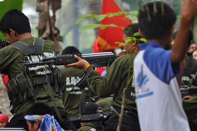 CONTINUING ATTACKS. NPA rebels in Mindanao carry AK-47s. File photo by Edwin Espejo