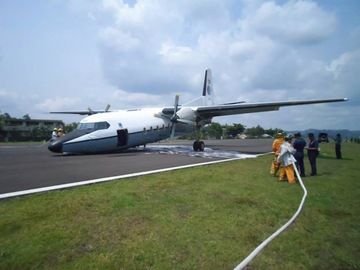NOSE DOWN. An Air Force F27 plane lies nose down on the runway of Legazpi Airport following a landing accident, May 11, 2015. Photo courtesy Office of Civil Defense-Bicol/Facebook