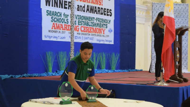 YOUTH LEADER. Jam Manalese, former president of the YES-O Network and current president of the Zero Waste Youth Pilipinas prepares trophies for the awarding of the city's most environmental schools. Photo by Khate Nolas