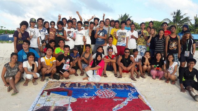 BACK HOME. This photo taken on December 26, 2015, provided by a group called Kalayaan Atin Ito (Kalayaan This Is Ours), shows Filipino youth posing for a photo at the island of Pag-asa, also known as Thitu, part of the disputed Spratly group of islands, in the South China Sea located off the coast of the western Philippines. Photo by Kalayaan Atin Ito/AFP