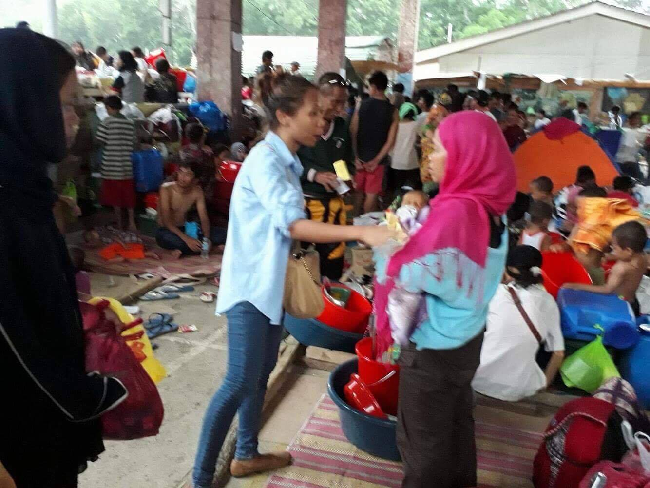 CROWDED. Najmah assists in the crowded evacuation center. Photo courtesy of Najmah Asum/YesPinoy