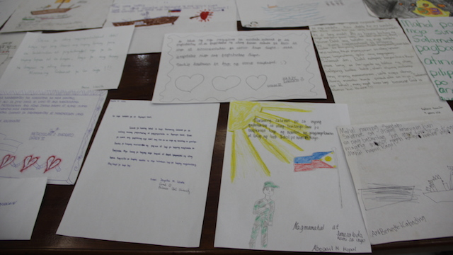 WORDS OF ENCOURAGEMENT: Students write letters for the troops in Ayungin Shoal. Photo from Western Command