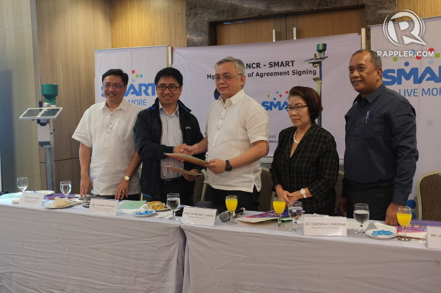 PARTNERING UP. DOST and Smart Communications officials formalize an agreement for the co-location of cell sites and automated rain gauges. Photo by Pia Ranada/Rappler