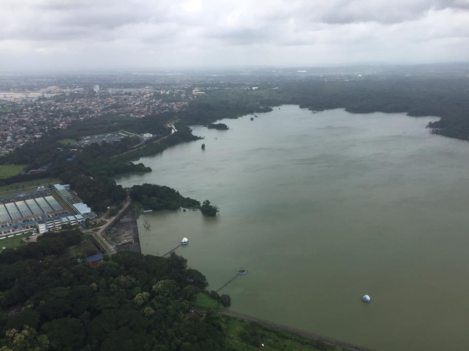 SWOLLEN DAM. This is an aerial photo of the swollen La Mesa Dam as of Monday noon, August 15. Photo courtesy of Sec Judy Taguiwalo
