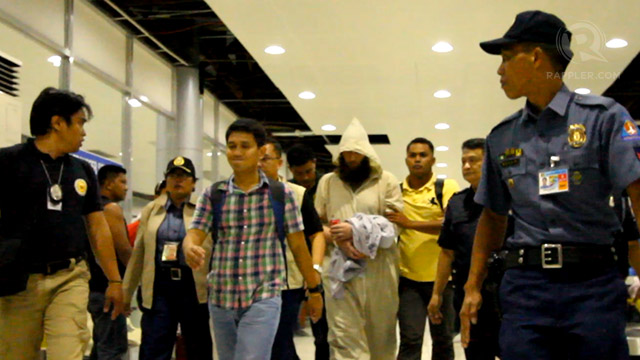 ARRESTED. Australian Musa Cerantonio arrives in Manila from Cebu. He is being kept at Camp Bagong Diwa in Bicutan. File photo by Edwin Llobrera