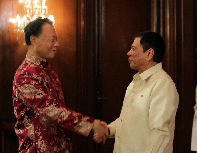 CONGRATULATING DUTERTE. Chinese Ambassador to the Philippines Zhao Jianhua (left) congratulates Philippine President Rodrigo Duterte after the new Philippine leader took his oath of office on June 30, 2016. Photo by EDP/Malacanang