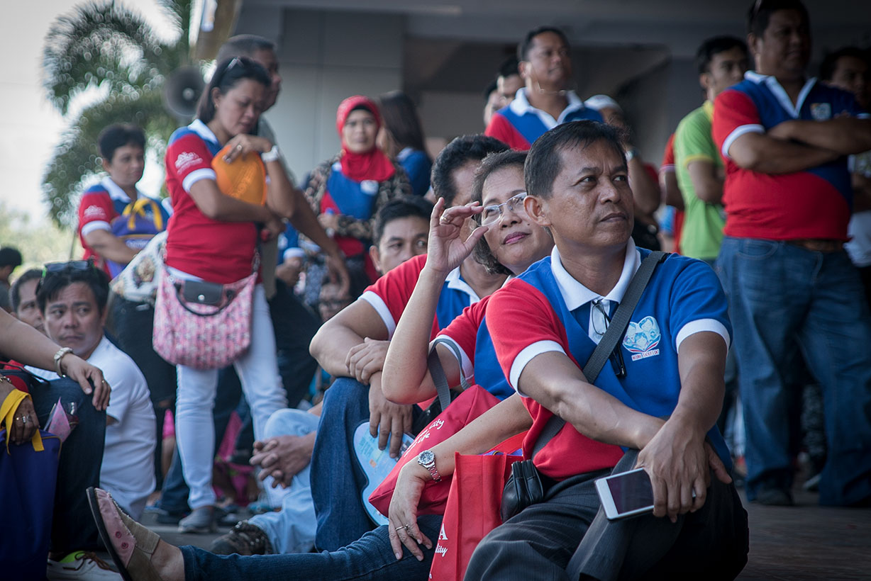 BREATHER FROM THE CLASSROOM. Teachers watch the program at the sidelines of the National Teachers' Day celebration in Legazpi City
