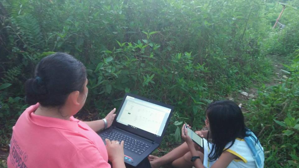 SEARCHING FOR INTERNET. Teachers from Libertad Elementary School climb mountains to get internet connection. Photo by Joseph Sumayang