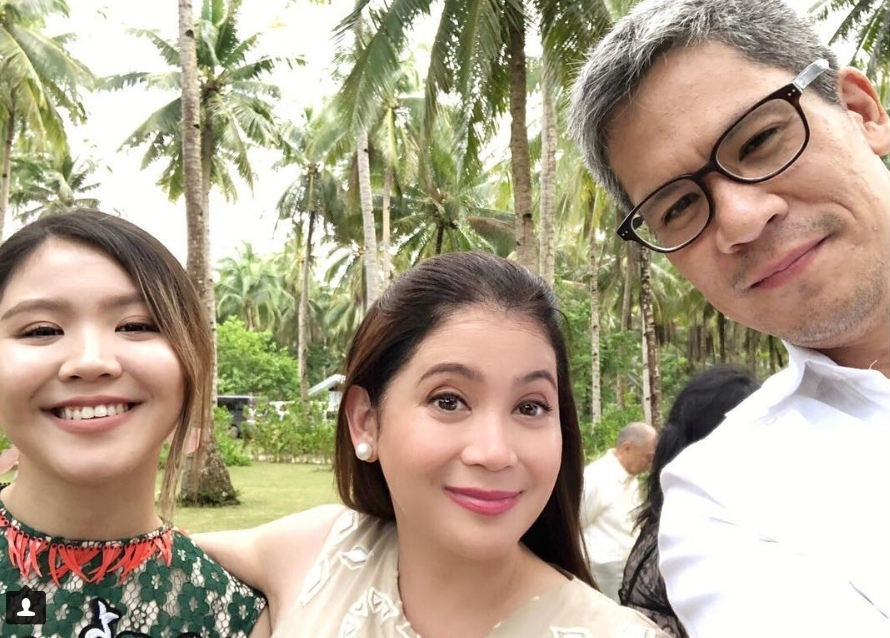 DAUGHTER AND BROTHER. Behind the busy life of a Tourism Secretary, Berna makes sure that family time always remains a priority. Photo courtesy of Berna Romulo Puyat