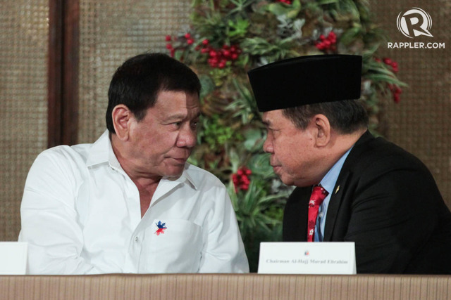 WAITING FOR THE NAMES. Photo shows President Rodrigo Duterte and MILF chairman Al Haj Murad Ebrahim during the signing of the executive order creating the expanded Bangsamoro Transition Council on November 7, 2016. OPAPP file photo
