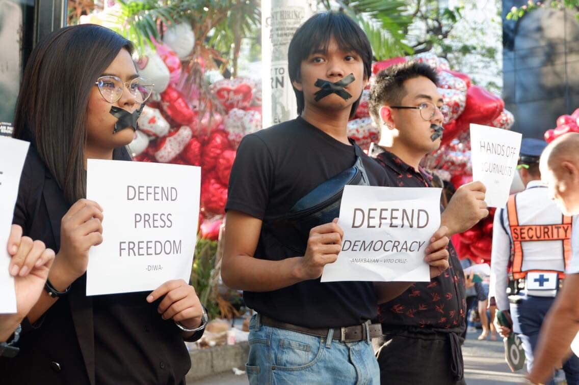 DEFEND DEMOCRACY. Progressive youth groups cover their mouths with black tape to highlight the importance of defending press freedom during a protest action along the Taft Vito Cruz area on February 14, 2019. Photo by Anakbayan Vito Cruz