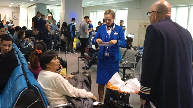 APPEASEMENT. Royal KLM staff address passenger concerns for the cancelled flight due to the closure of the Ninoy Aquino International Airport. Photo courtesy of Manja Bayang