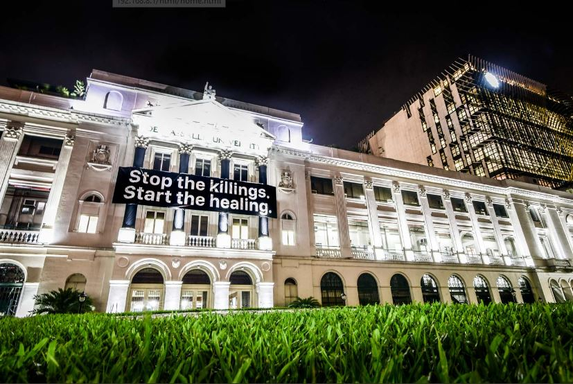 STOP THE KILLING. A bannercalling for an end to killings drapes the St. La Salle Hall on Wednesday evening, September 20. Photo by Alecs Ongcal/Rappler