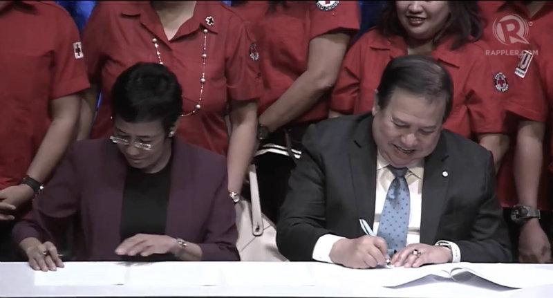 PARTNERSHIP. Rappler CEO Maria Ressa and Philippine Red Cross Chairman and Senator Richard Gordon inks the memorandum of agreement for disaster risk reduction. Photo from Rappler