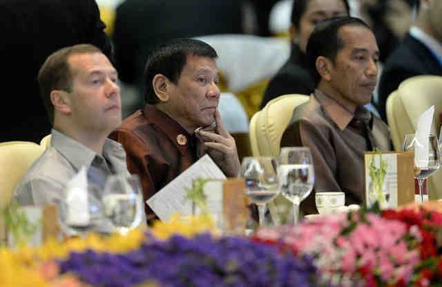 DUTERTE'S FOREIGN POLICY. President Rodrigo Duterte sits between Russian Prime Minister Dmitry Medvedev (L) and Indonesia's President Joko Widodo at the gala dinner during the ASEAN Summit in Vientiane on September 7, 2016. Photo by Noel Celis/AFP