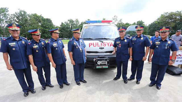 NEW EQUIPMENT. Purisima also turns over a new vehicle, assault riffles, ammunition, and cash assistance. Photo courtesy of the PNP PIO