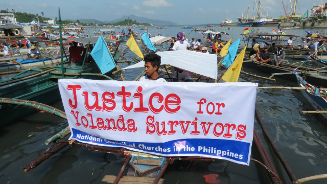 DEMANDING JUSTICE. Fishermen from Serum, Basey in Samar arrive at the Old Jeep Terminal Rizal Avenue in Tacloban City to meet with other protestors joining the people surge. Photos by Catherine Atienza/ Rappler