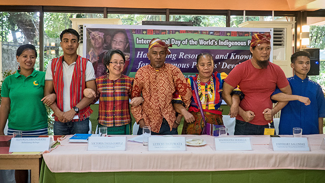 INDIGENOUS PEOPLES' DAY. UN special rapporteur Victoria Tauli-Corpuz (3rd from L) link arms with indigenous leaders including Lambangian tribe leader Leticio Datuwata (4th from L) and Kulamanen Matigsalog Migsabela chairperson Magdalena Suhat-Herbilla during the celebration of the International Day of the World's Indigenous peoples on August 9, 2017 at the University of the Philippines Diliman in Quezon City