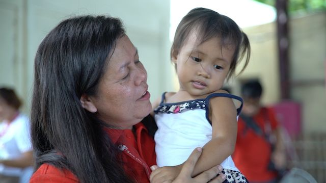 MOTHERHOOD. Even if she's never had a child, Erlinor Umali feels she's a mother to the children she helps as a development worker.